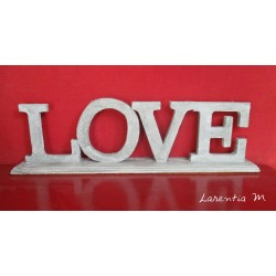 "Wood letters ""Love"" Stand covered with concrete texture"