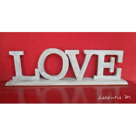 """Wood letters """"Love"""" Stand covered with concrete texture"""