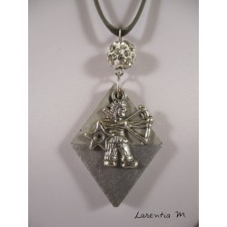 "Pendant necklace zodiac sign ""Sagittarius"" with white shamballa pearl diamond on concrete pedestal decorated grey"