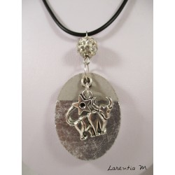 "Necklace with zodiac sign ""Taurus"" with white shamballa bead on oval concrete base decorated with silver"