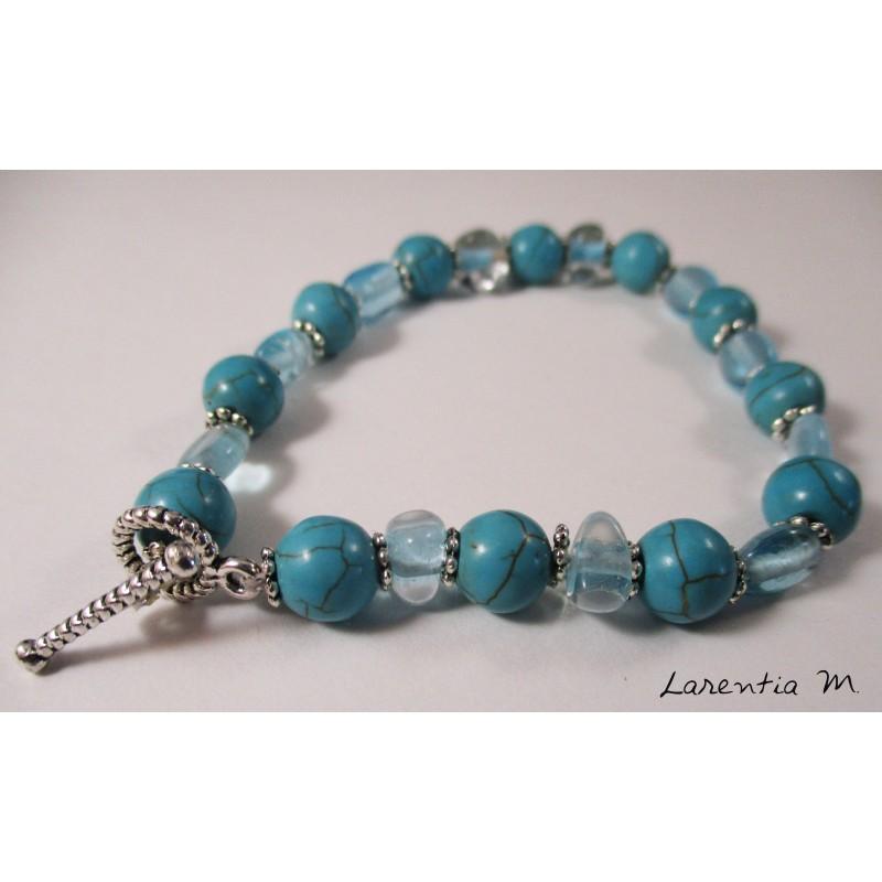 Bracelet perles turquoises, transparentes et fleurs argentées