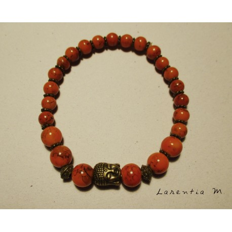 Bracelet perles pierres orangées, tête  bouddha vieil or