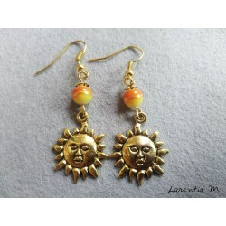Orange and yellow pearl earrings with golden sun