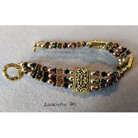 3 rows bracelet in Swarovski crystal beads, brown and black gradient, golden antique metal dividers, toggle clasp