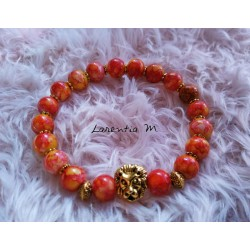 Glass beads bracelet 8mm orange speckled, golden lion head - Elastic