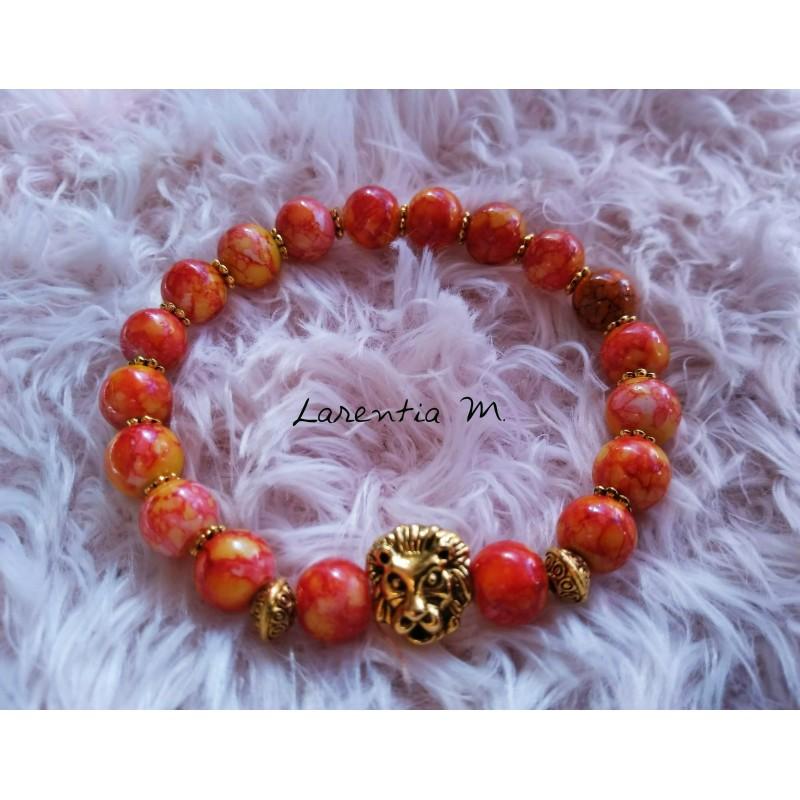 Bracelet perles verre 8mm orangées mouchetées, tête de lion dorée - Elastique