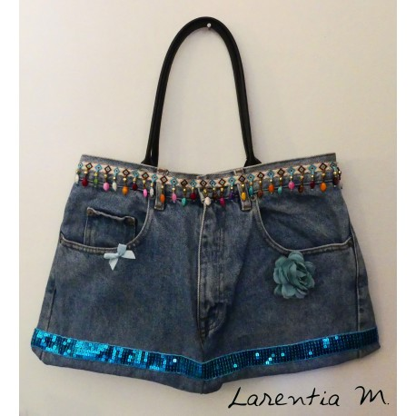 Denim bag with multicolored pearl ribbon, turquoise and pink glittery fabric ribbon, faux leather handles.