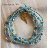 Bracelet 5 rows in seed beads blue-gold tones, fairy on gold moon
