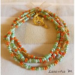 Bracelet 5 rangs en perles de rocaille tons vert-or, soleil doré