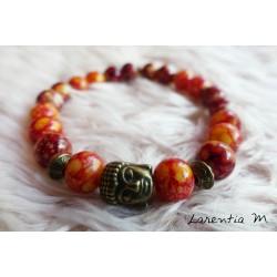Bracelet perles verre 8mm orangées et rouille, tête bouddha vieil bronze, élastique
