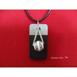 Pendant Necklace white and silver pearl on rectangle concrete pad painted black