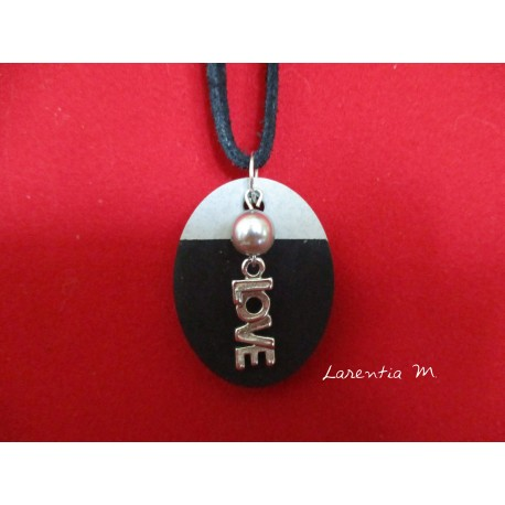 "Pendant Necklace ""Love"" with grey waxed pearl on oval concrete pad painted black"