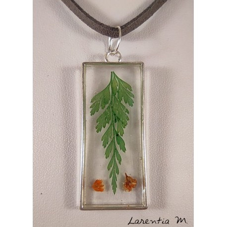 Silver and transparent resin pendant with fern and red flowers, gray suede cord
