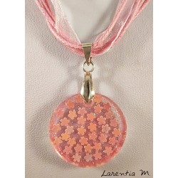 Resin pendant necklace with glitter and pink flowers, pink ribbon and cords