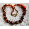 Necklace made with an orange scarf and wooden beads. Pretty heart-shaped clasp