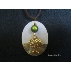 "Necklace, pendant ""Tree of life"" with green magic pearl on concrete pad decorated gold"